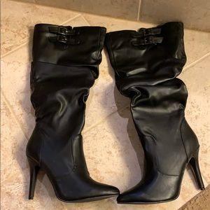 Black heel boots. Never worn